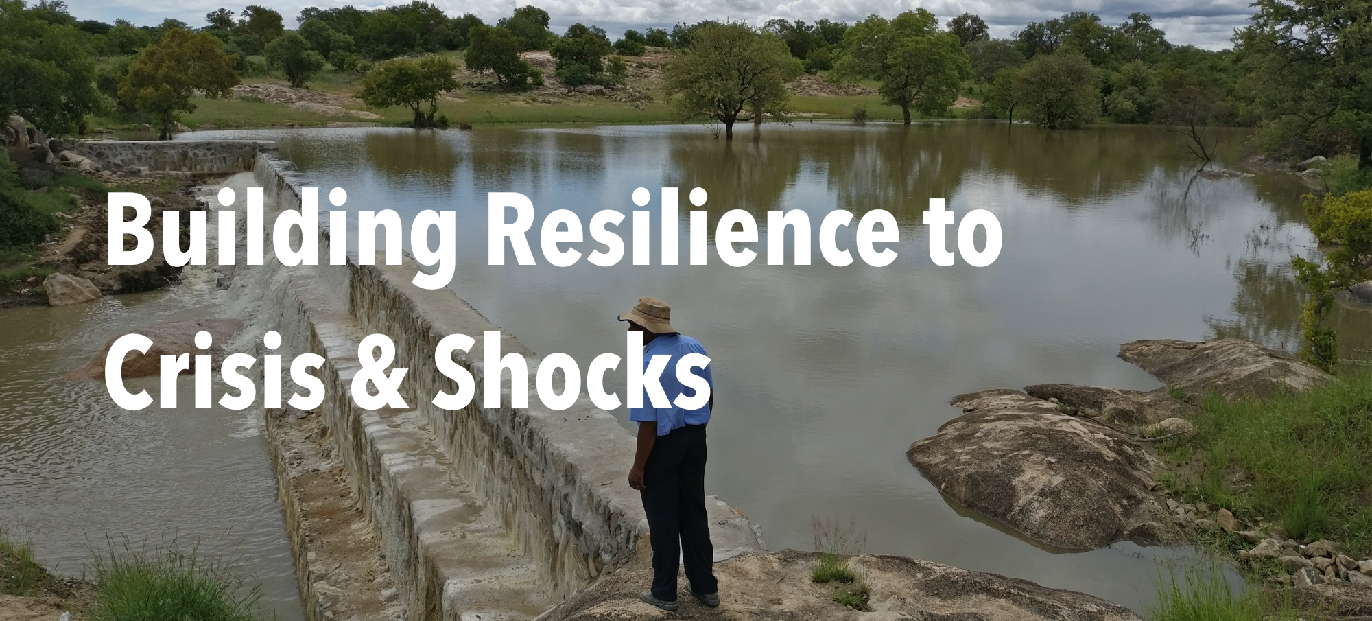 """Man in front of dam in Zimbabwe with header text """"Building Resilience to Crisis & Shocks"""""""