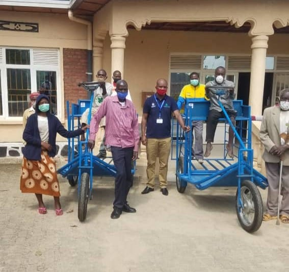 Members of the Twisungane Mageragere cooperative with appropriate post-harvest equipment and tricycles.
